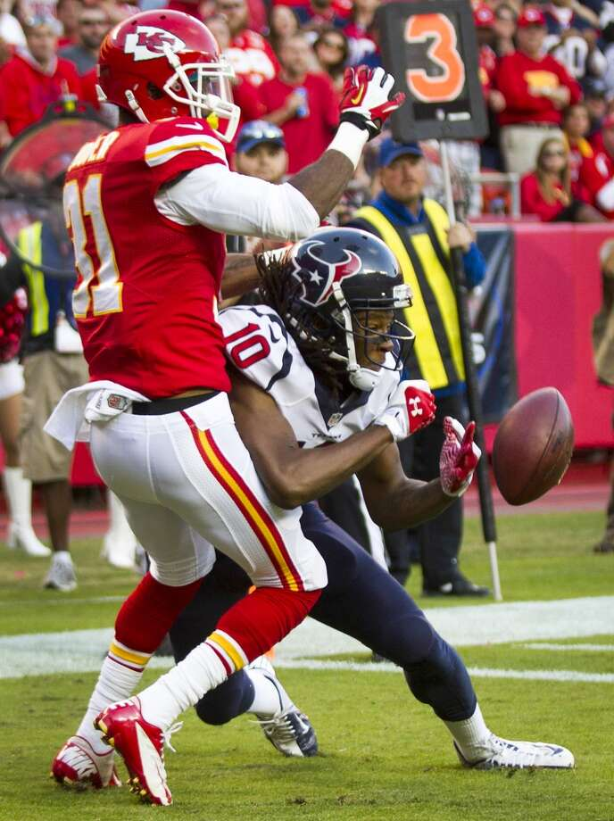 Chiefs cornerback Marcus Cooper breaks up a pass in the end zone intended for Texans wide receiver DeAndre Hopkins during the third quarter. Photo: Brett Coomer, Houston Chronicle