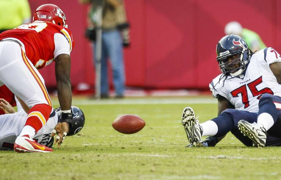 Texans quarterback Case Keenum fumbles as he is sacked by Chiefs linebacker Justin Houston during the fourth quarter. Photo: Brett Coomer, Houston Chronicle
