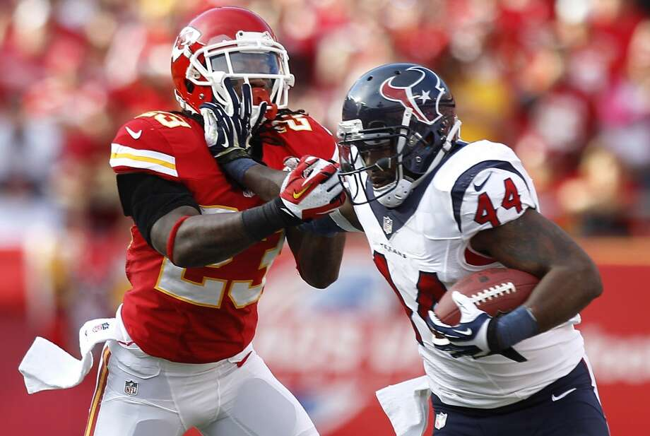 Texans running back Ben Tate  pushes off Chiefs free safety Kendrick Lewis. Photo: Brett Coomer, Houston Chronicle