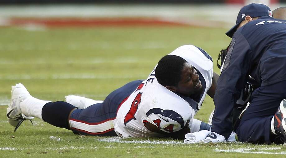 Texans running back Ben Tate grimaces after he was injured during the third quarter. Photo: Brett Coomer, Houston Chronicle