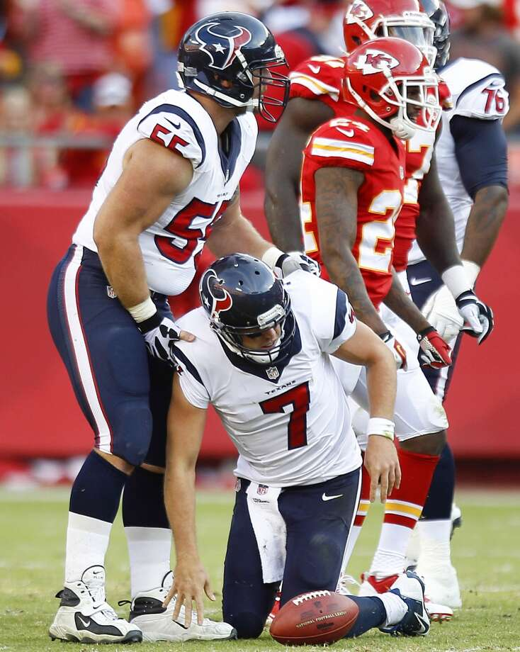 Texans center Chris Myers picks up quarterback Case Keenum after he was sacked during the third quarter. Photo: Brett Coomer, Houston Chronicle