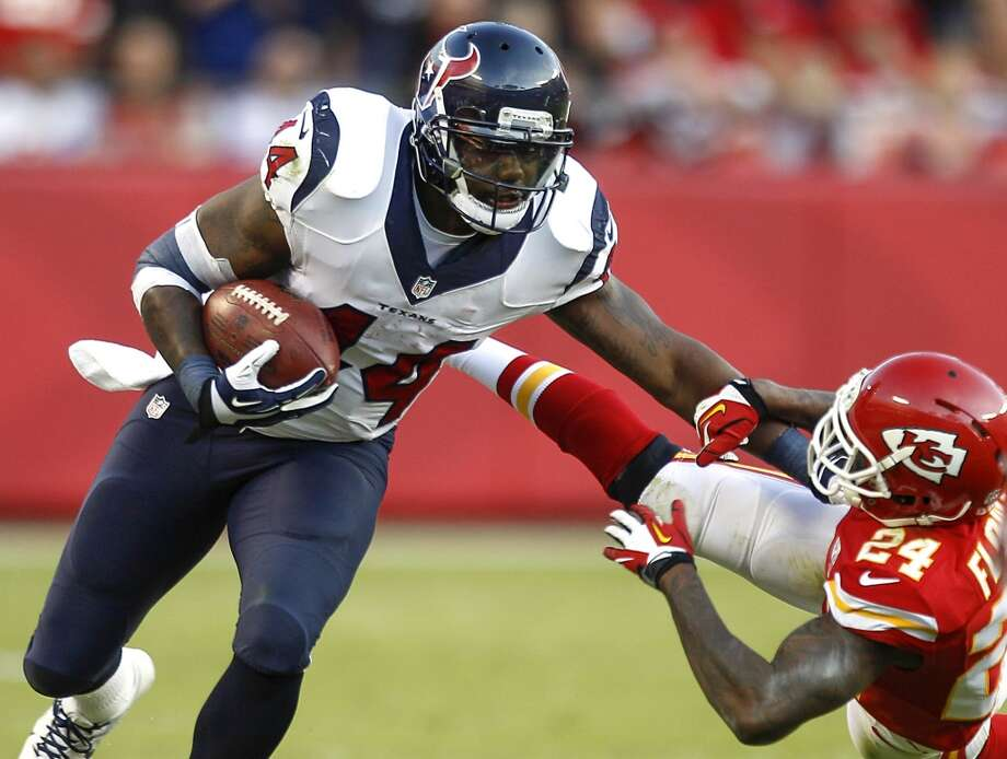 Texans running back Ben Tate is hit by Chiefs cornerback Brandon Flowers during the third quarter. Photo: Brett Coomer, Houston Chronicle