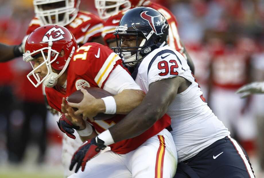 Texans nose tackle Earl Mitchell sacks Chiefs quarterback Alex Smith during the third quarter. Photo: Brett Coomer, Houston Chronicle