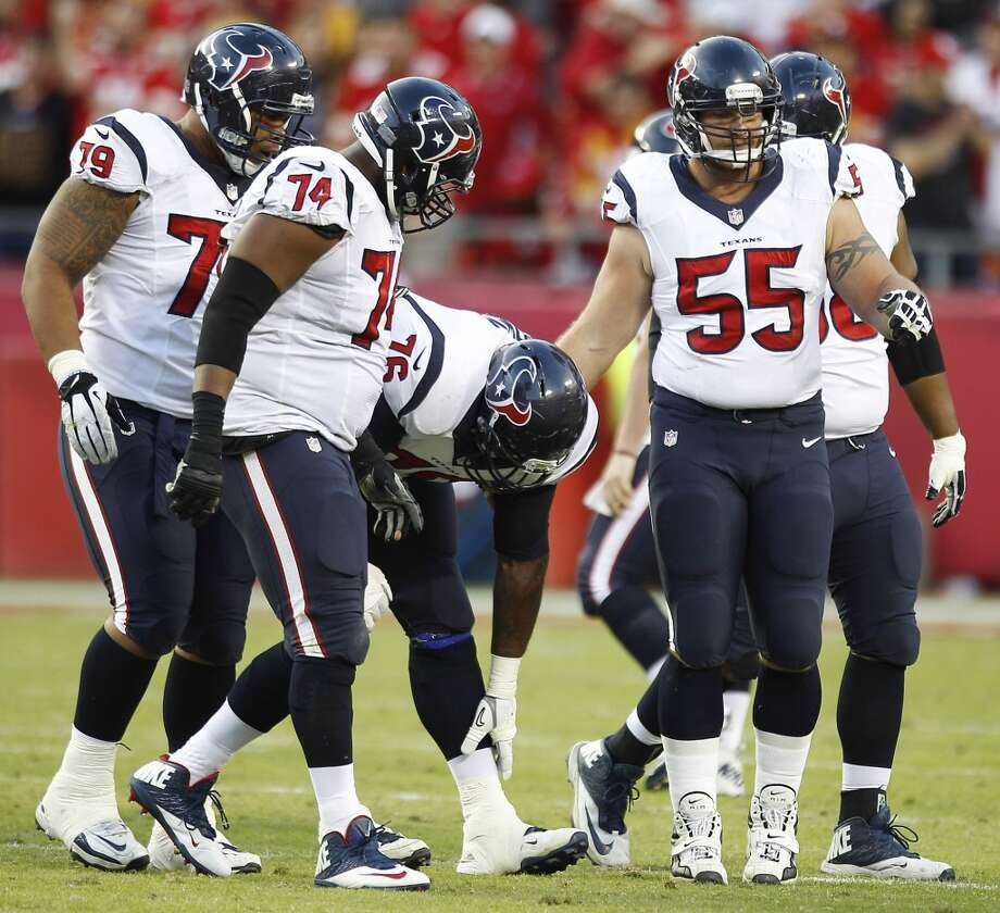 Texans tackle Duane Brown (76) reaches down to hold his shin as he limps off the field during the fourth quarter. Photo: Brett Coomer, Houston Chronicle