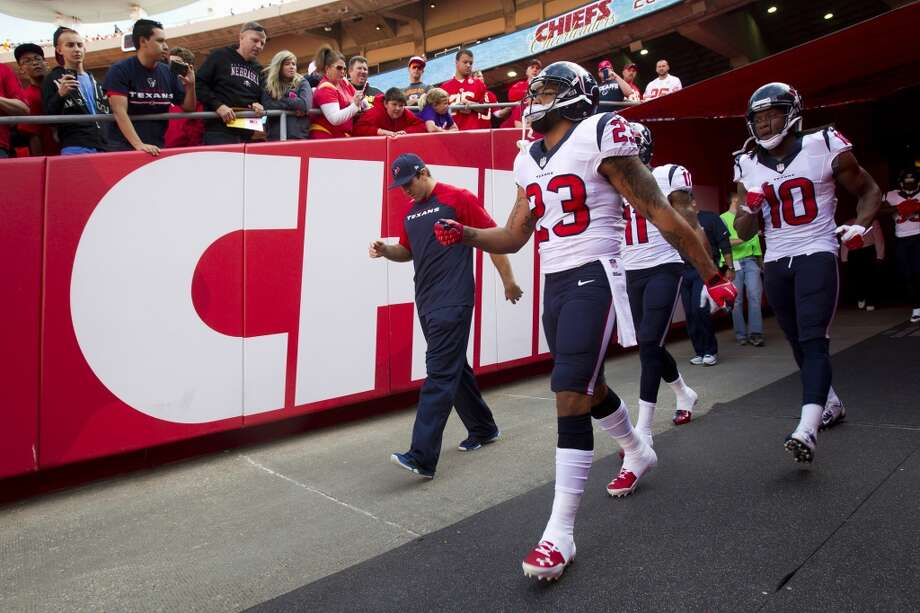 Texans running back Arian Foster (23) and  wide receiver DeAndre Hopkins (10) walk out of the tunnel before the game. Photo: Brett Coomer, Houston Chronicle