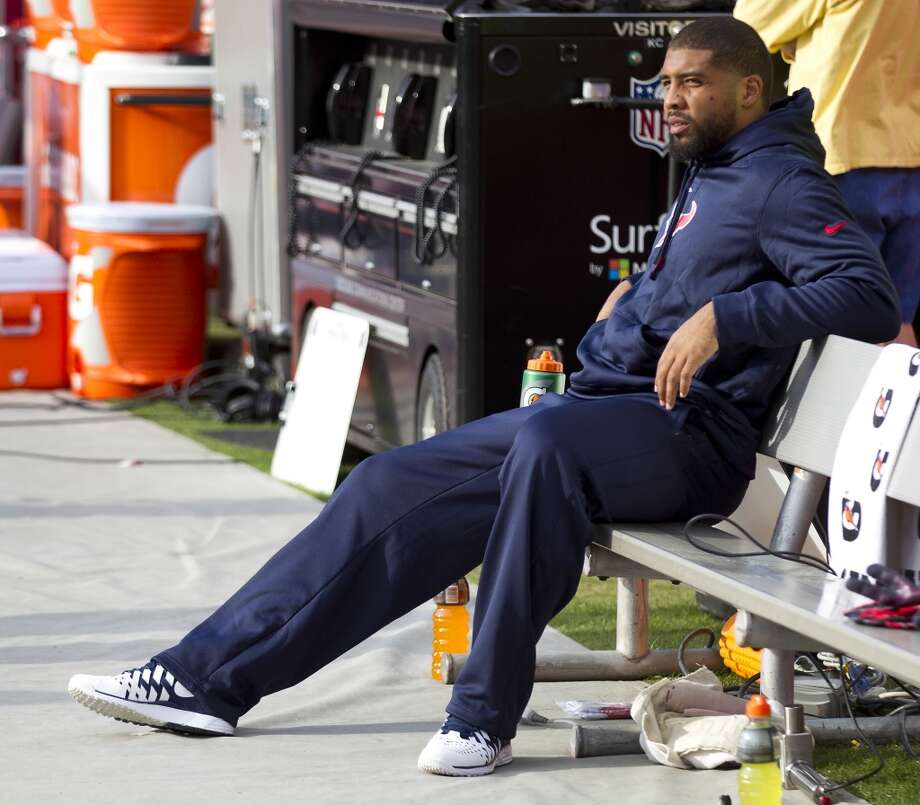 Texans running back Arian Foster sits on the bench after leaving the game. Photo: Brett Coomer, Houston Chronicle