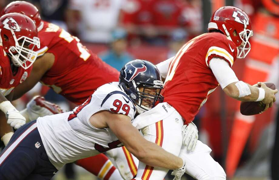 Texans defensive end J.J. Watt (99) sacks Chiefs quarterback Alex Smith (11). Photo: Brett Coomer, Houston Chronicle