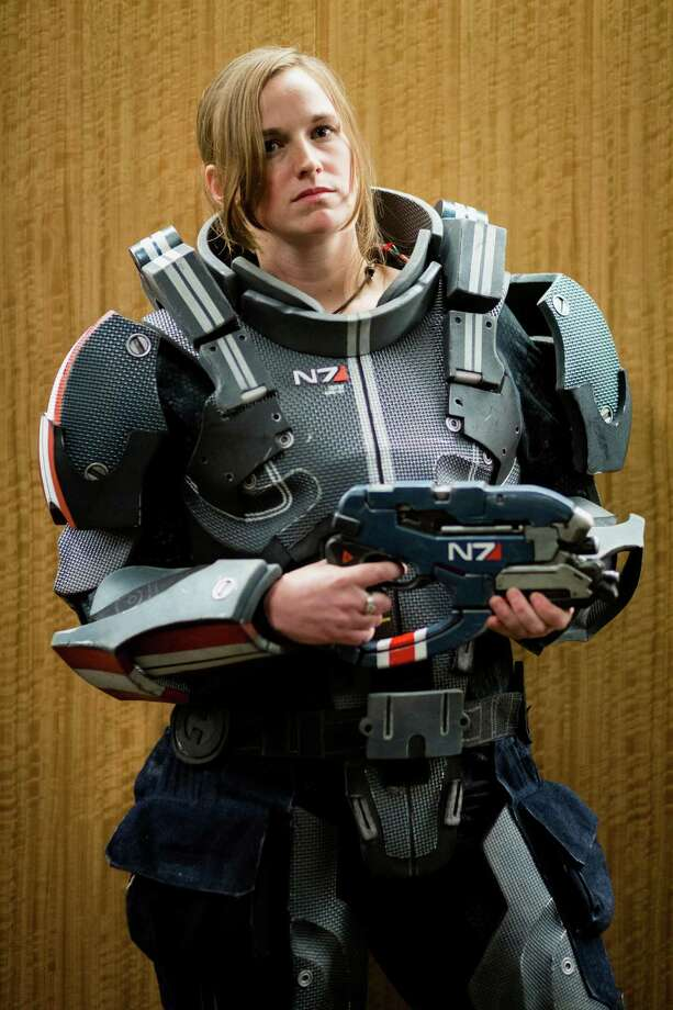 "April Ness, dressed as a character from Mass Effect, poses for a portrait at GeekGirlCon Saturday, Oct. 19, 2013, in the Seattle Conference Center in Seattle. ""Created by geeky women for geeky women,"" GeekGirlCon boasts multiple floors of panels, merch and a costume contest.  Photo: JORDAN STEAD, SEATTLEPI.COM / SEATTLEPI.COM"