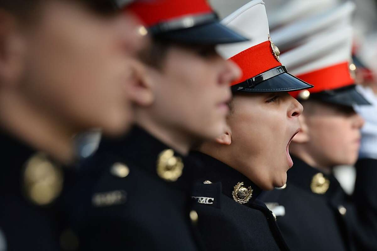 TOPSHOTS A Royal Marine Cadet yawns as he takes part in a parade in London's Trafalgar Square on October 20, 2013, to mark the anniversary of the Battle of Trafalgar. The Battle of Trafalgar was fought on October 21, 1805. AFP PHOTO/BEN STANSALLBEN STANSALL/AFP/Getty Images