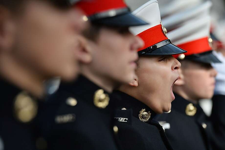 TOPSHOTS A Royal Marine Cadet yawns as he takes part in a parade in London's Trafalgar Square on October 20, 2013, to mark the anniversary of the Battle of Trafalgar. The Battle of Trafalgar was fought on October 21, 1805. AFP PHOTO/BEN STANSALLBEN STANSALL/AFP/Getty Images Photo: Ben Stansall, AFP/Getty Images