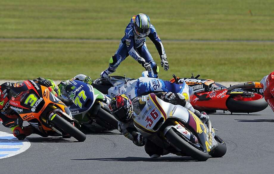 Moto2 rider Julian Simon of Spain, top, crashes on Turn Four during the Australian Motorcycle Grand Prix in Phillip Island, Australia, Sunday, Oct. 20, 2013.  Pol Espargaro of Spain won the race with Thomas Luthi of Switzerland coming in second and Jordi Torres of Spain third. (AP Photo/Andrew Brownbill) Photo: Andrew Brownbill, Associated Press
