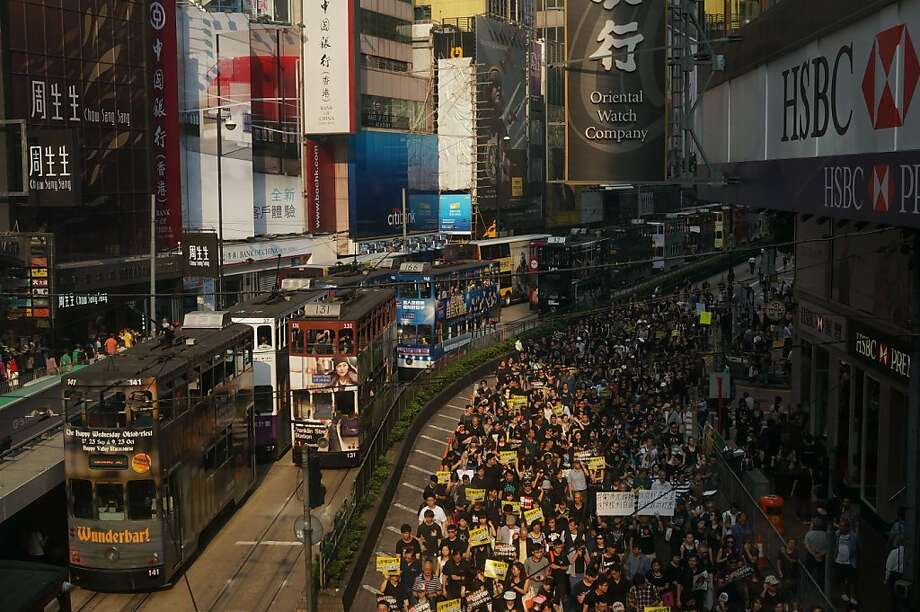 TOPSHOTS Tens of thousands of protesters march down the streets of Hong Kong on October 20, 2013. Scores of people protested on October 20 against the government's surprise decision to not grant a broadcasting license to HKTV, a station which promised high quality programming, in a move which they say will hamper the city's creative industry. The city's television airwaves are currently dominated by one broadcaster. AFP PHOTO / AARON TAMaaron tam/AFP/Getty Images Photo: Aaron Tam, AFP/Getty Images