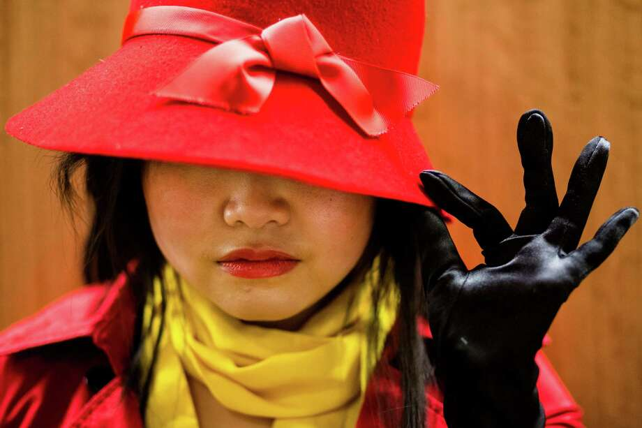 "Vicky Yan, dressed as Carmen Sandiego, poses for a portrait at GeekGirlCon Saturday, Oct. 19, 2013, in the Seattle Conference Center in Seattle. ""Created by geeky women for geeky women,"" GeekGirlCon boasts multiple floors of panels, merch and a costume contest. The sold-out event continues Sunday. Photo: JORDAN STEAD, SEATTLEPI.COM / SEATTLEPI.COM"