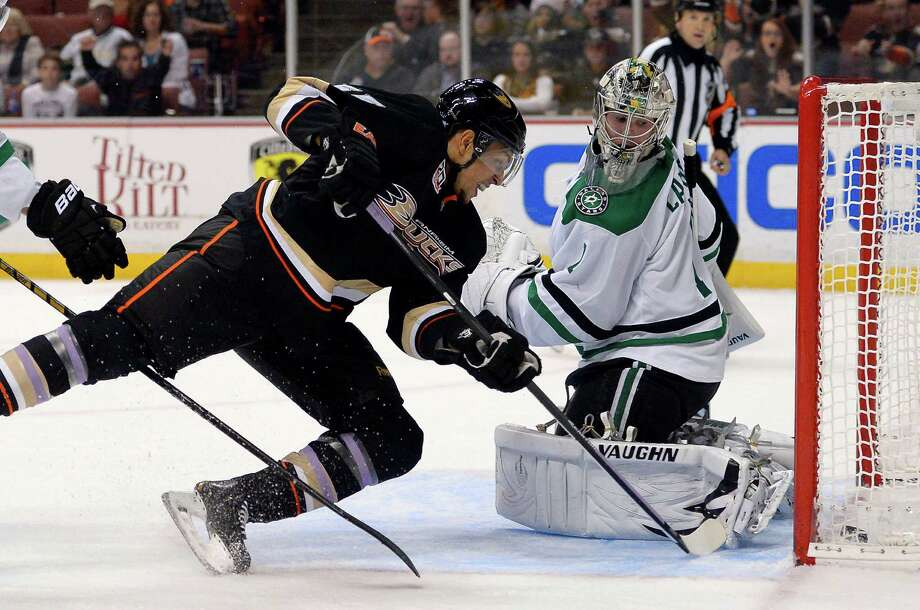Anaheim Ducks right wing Emerson Etem, left, scores on Dallas Stars goalie Jack Campbell during the second period of their NHL hockey game, Sunday, Oct. 20, 2013, in Anaheim, Calif. (AP Photo/Mark J. Terrill) ORG XMIT: ANA107 Photo: Mark J. Terrill / AP