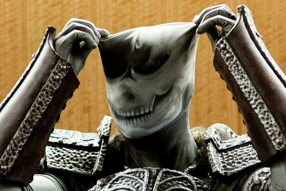 "Bill Doran adjusts his under layer before posing for a portrait at GeekGirlCon Saturday, Oct. 19, 2013, in the Seattle Conference Center in Seattle. ""Created by geeky women for geeky women,"" GeekGirlCon boasts multiple floors of panels, merch and a costume contest. The sold-out event continues Sunday. Photo: JORDAN STEAD, SEATTLEPI.COM / SEATTLEPI.COM"