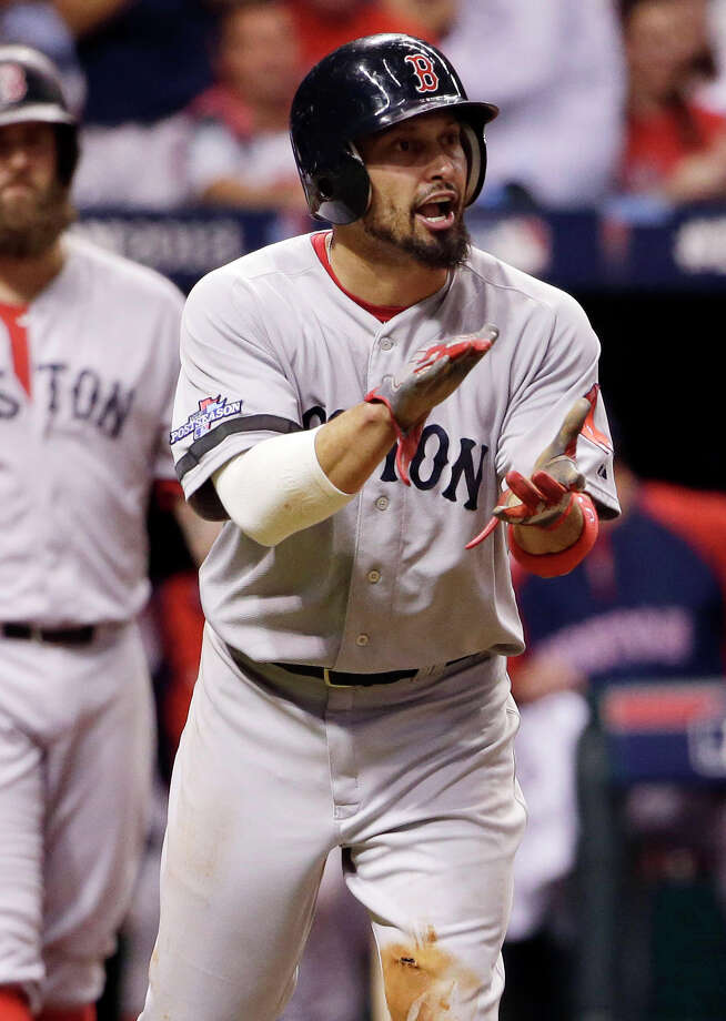 Boston Red Sox's Shane Victorino applauds teammate David Ortiz after Victorino scored on a hit by Ortiz in the fifth inning in Game 3 of an American League baseball division series against the Tampa Bay Rays, Monday, Oct. 7, 2013, in St. Petersburg, Fla. (AP Photo/Chris O'Meara) Photo: Chris O'Meara, STF / AP