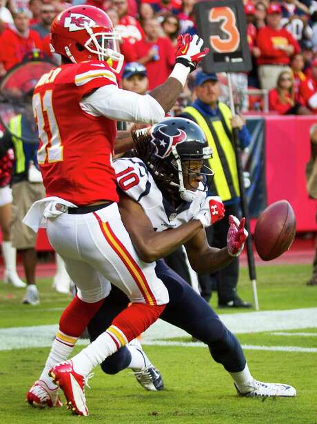 Chiefs cornerback Marcus Cooper (31) breaks up a pass in the end zone intended for Texans receiver DeAndre Hopkins, who had three receptions for 76 yards. Photo: Brett Coomer, Staff / © 2013  Houston Chronicle