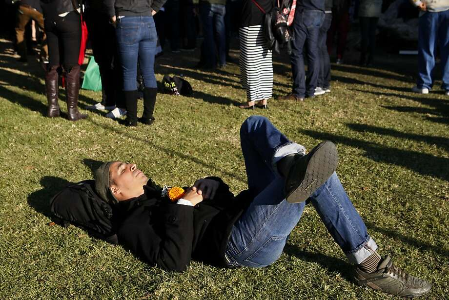 Sebastian Alvarez of Oakland rests on the grass near the Bridge Stage at the Treasure Island Music Festival in San Francisco, Calif. on Sunday, Oct. 20, 2013. Photo: Raphael Kluzniok, The Chronicle