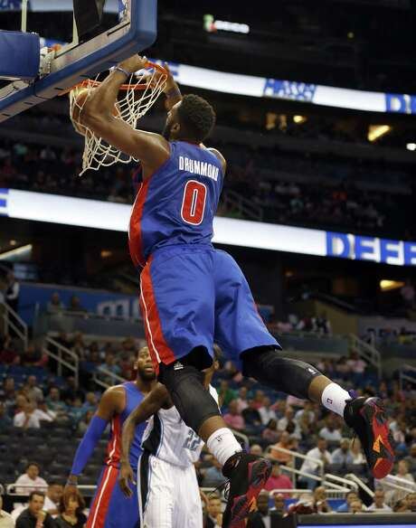 Detroit's Andre Drummond dunks in the first half against the Magic. The big man had 14 points and 15 rebounds. Photo: Reinhold Matay / Associated Press