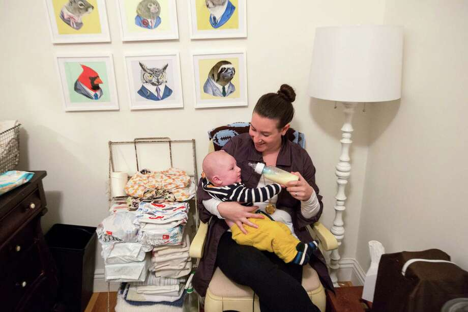 Rachel Holtzman feeds her son, Levi, with donated breast milk from a network of women in New York. A report found such breast milk was often contaminated. Photo: JAMES ESTRIN, STF / NYTNS