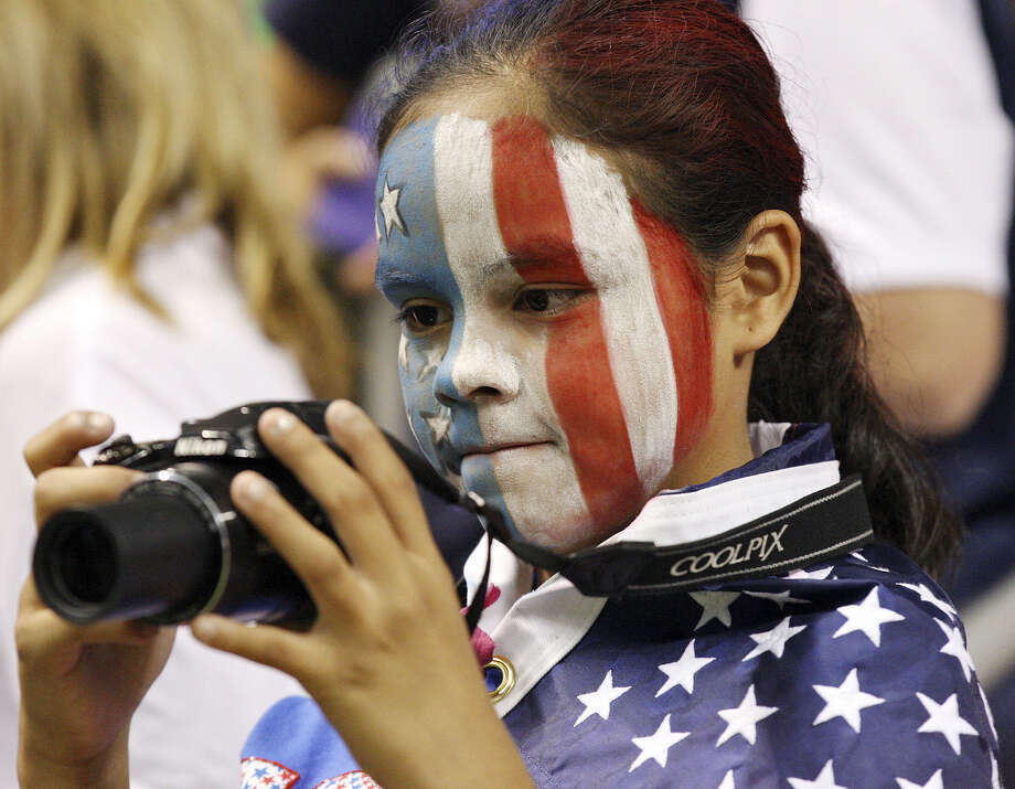 Soccer fan Kay-Lani Vasquez photographs players before the match, which drew 19,109 people to the dome.