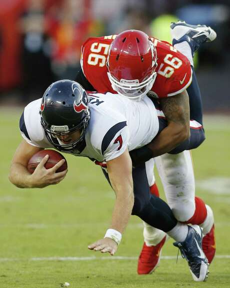Texans QB Case Keenum, being sacked by Chiefs linebacker Derrick Johnson, had Houston in position to win late in his first NFL start. Photo: Ed Zurga / Associated Press