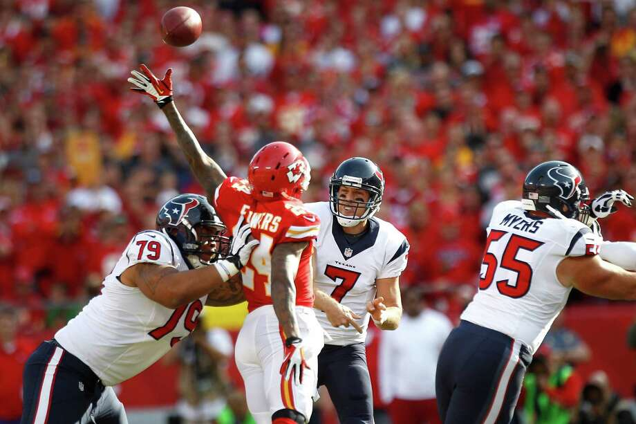 Texans quarterback Case Keenum delivers under pressure - something he did often in his professional debut against the Chiefs. Photo: Brett Coomer, Staff / © 2013  Houston Chronicle