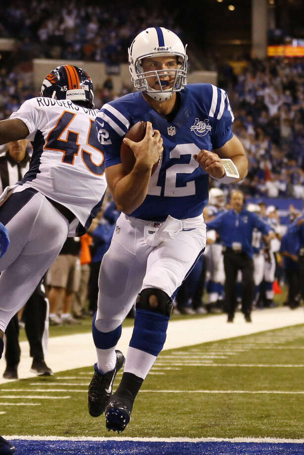 Indianapolis quarterback Andrew Luck runs for a touchdown in the third quarter of the Colts' victory over Denver on Sunday night at Lucas Oil Stadium. Photo: Sam Riche / McClatchy-Tribune News Service