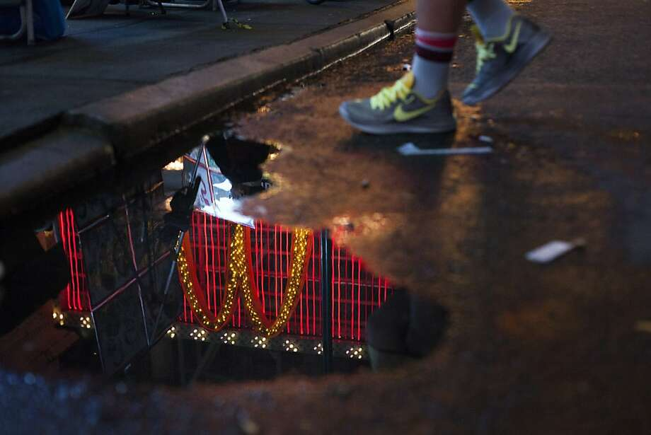 A McDonald's Corp. logo is reflected in a puddle in front of a restaurant on 42nd Street in Times Square in New York, U.S., on Saturday, October 20, 2013. McDonald's is scheduled to release quarterly earnings on Oct. 21. Photographer: Michael Nagle/Bloomberg Photo: Michael Nagle, Bloomberg