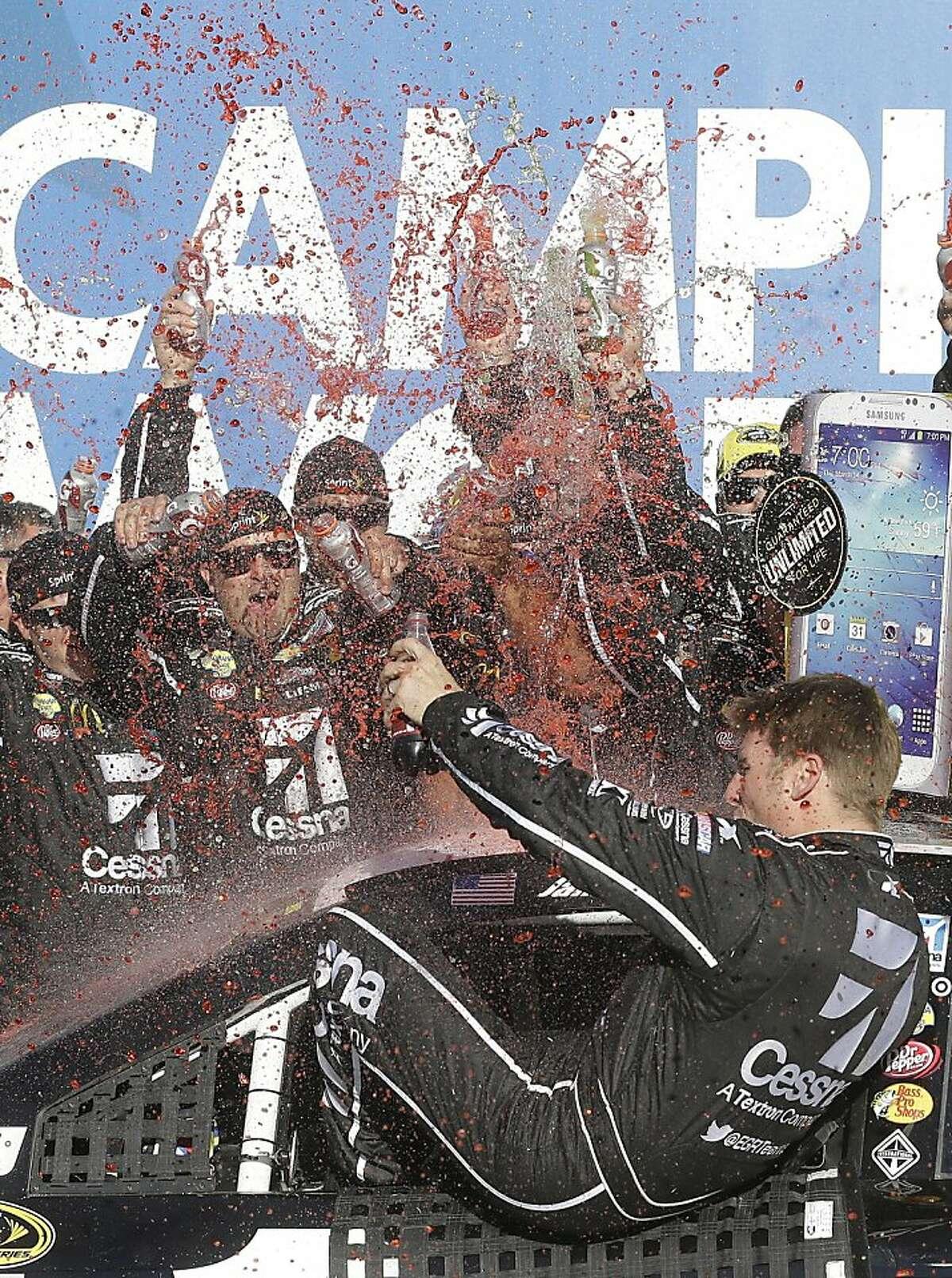 Sprint Cup Series driver Jamie McMurray (1) celebrates after winning the NASCAR Sprint Cup Series auto race at the Talladega Superspeedway in Talladega, Ala., Sunday, Oct. 20, 2013.(AP Photo/Jay Sailors)
