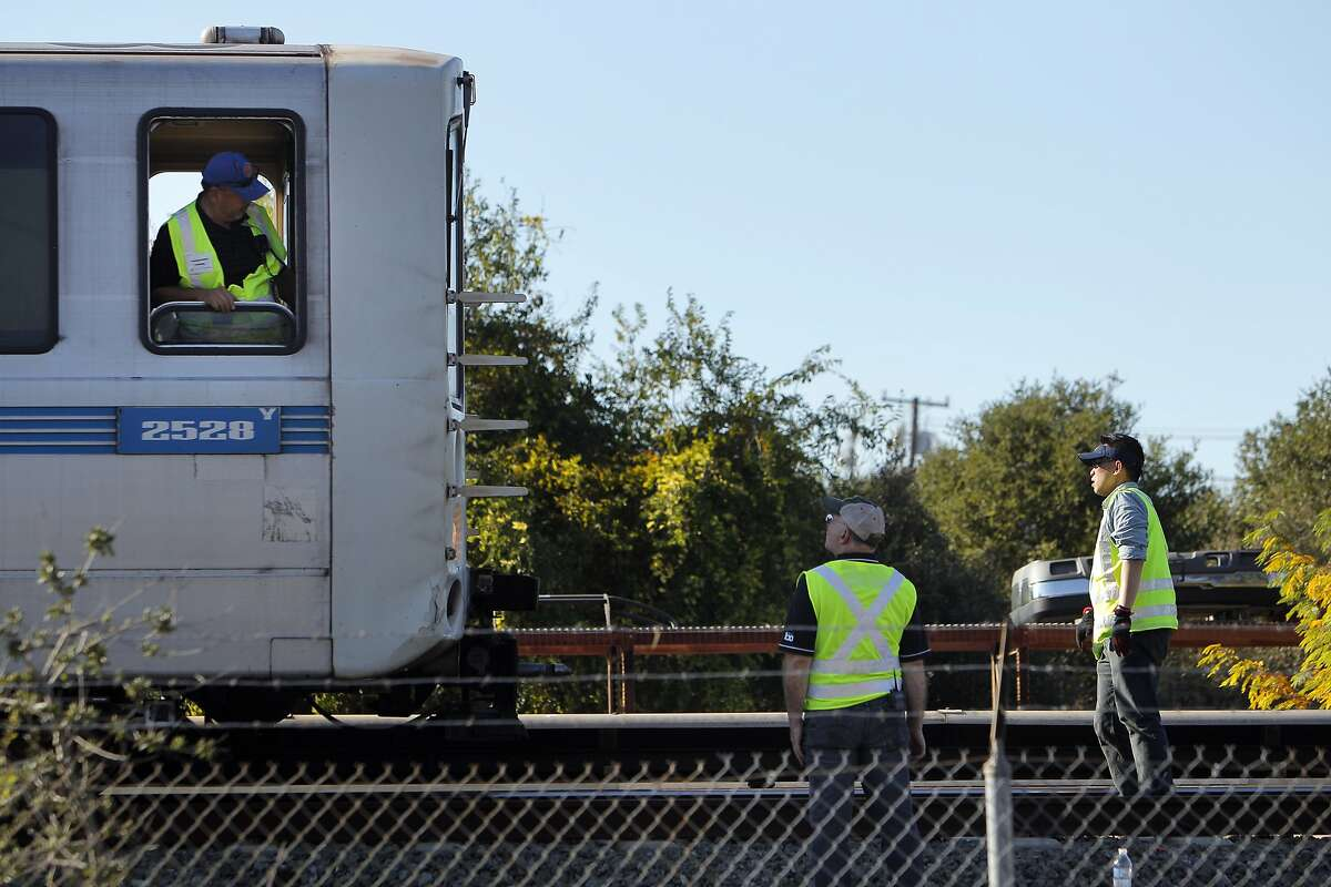 BART personnel confer on Sunday, October 20, 2013, before removing a train that was involved in a fatal collision, Saturday. Investigators from the NTSB have on Sunday, October 20, 2013, taken over the investigation into the Saturday's fatal BART train accident in Walnut Creek, Calif.