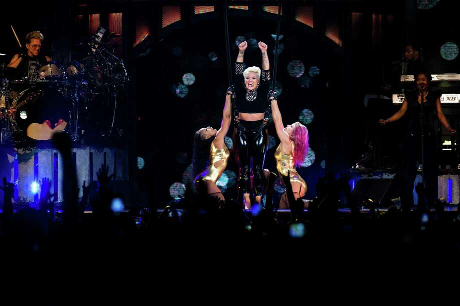 "P!nk performs on the opening night of her ""The Truth About Love Tour"" Sunday, Oct. 20, 2013, at KeyArena in Seattle. The 30-stop tour kicked off in Seattle and will conclude Brooklyn. Photo: JORDAN STEAD, SEATTLEPI.COM / SEATTLEPI.COM"