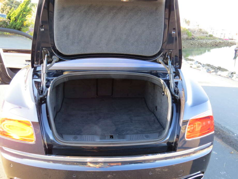 The Flying Spur's 16.8 cubic foot trunk will hold the requisite number of bags for a weekend trip.