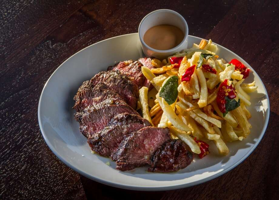 The grilled black Angus Steak with fries at Pesce in San Francisco. Photo: John Storey, Special To The Chronicle
