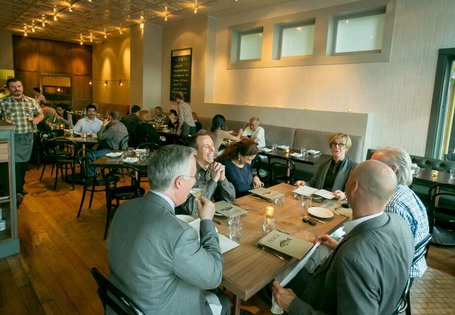People enjoy dinner at Pesce in San Francisco. Photo: John Storey, Special To The Chronicle