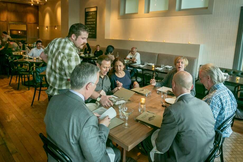 People enjoy dinner at Pesce in San Francisco Photo: John Storey, Special To The Chronicle
