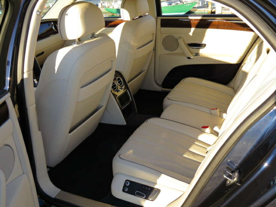 Rear-seat passengers get their own DVD screens (not installed on this particular car). The rear seats are also multi-way adjustable.