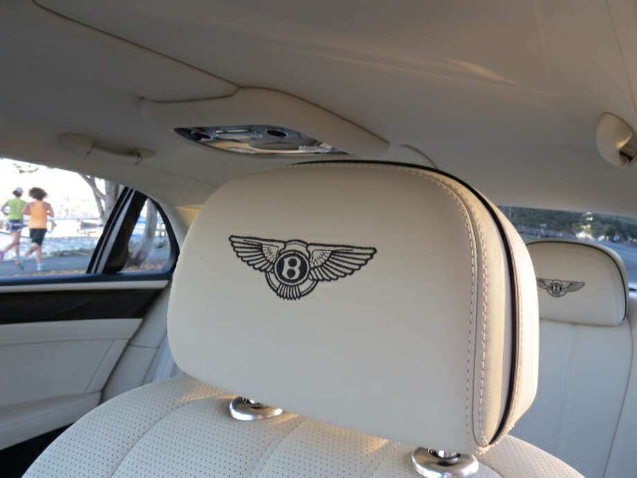 "The Bentley logo is distinctive and in this creamy interior, you expect a chauffeur to pop up from the center console and murmur, ""sir, if you please, kindly sit in the rear and I shall take you to the Garrick."""