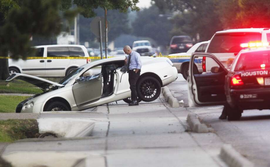 Houston Police Department homicide detectives are looking into the shooting death of a man early Monday morning inside this Bentley luxury automobile near Richmond and Fountainview. Photo: Johnny Hanson, Houston Chronicle