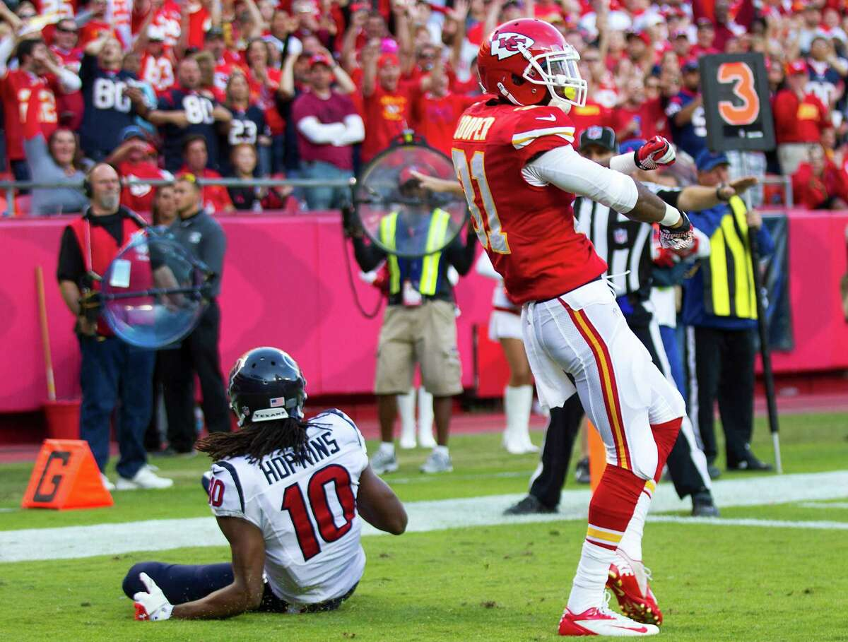 Kansas City Chiefs cornerback Marcus Cooper (31) celebrates after breaking up in the end zone intended for Houston Texans wide receiver DeAndre Hopkins (10) during the third quarter of an NFL football game at Arrowhead Stadium Sunday, Oct. 20, 2013, in Kansas City.