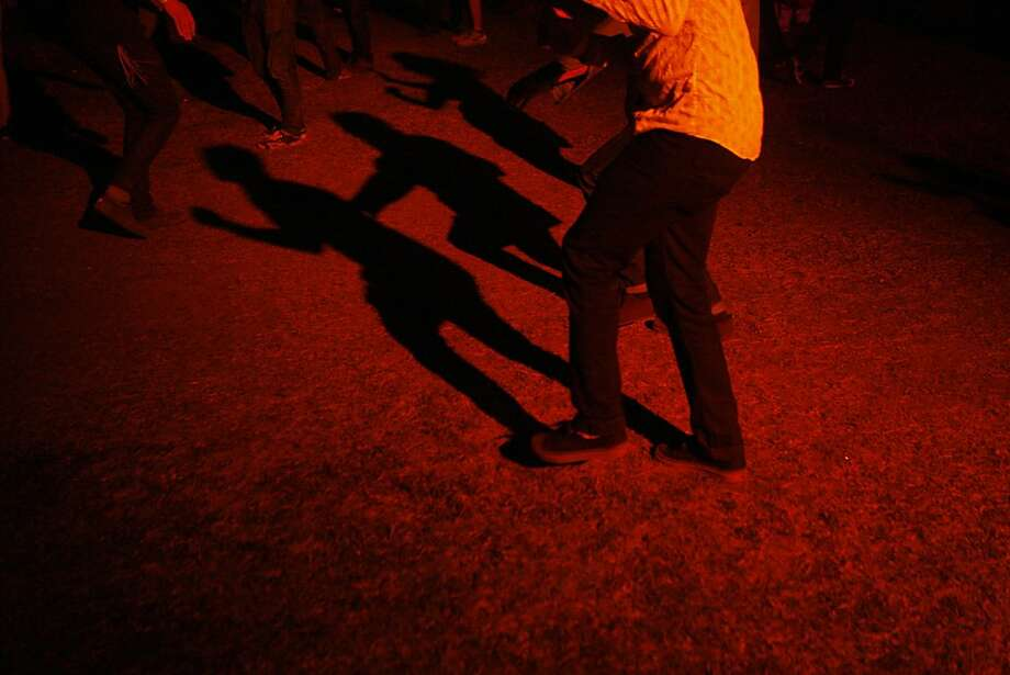 The shadows of festival goers are seen as the dance to Animal Collective at the Treasure Island Music Festival in San Francisco, Calif. on Sunday, Oct. 20, 2013. Photo: Raphael Kluzniok, The Chronicle