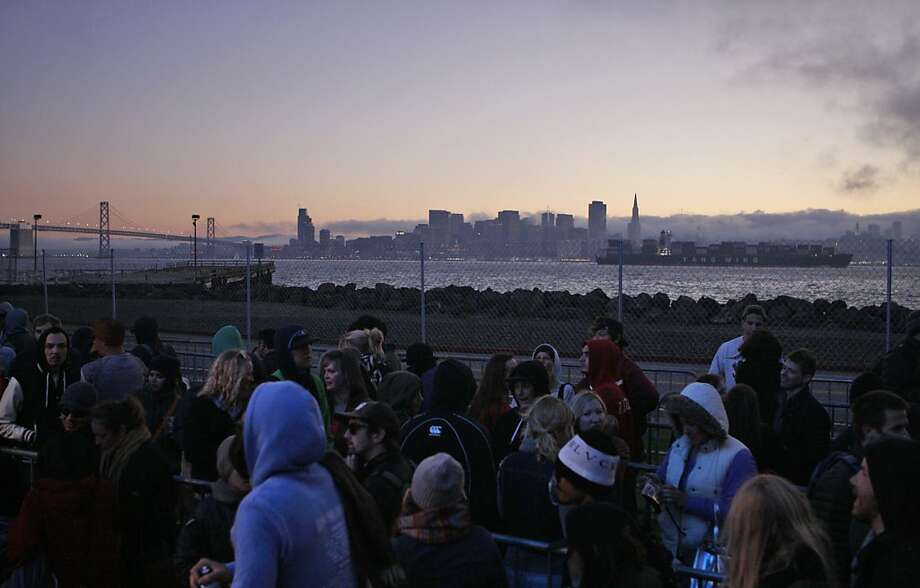 Festival goers wait in line for the ferris wheel as a cargo ship passes by San Francisco at the Treasure Island Music Festival in San Francisco, Calif. on Sunday, Oct. 20, 2013. Photo: Raphael Kluzniok, The Chronicle