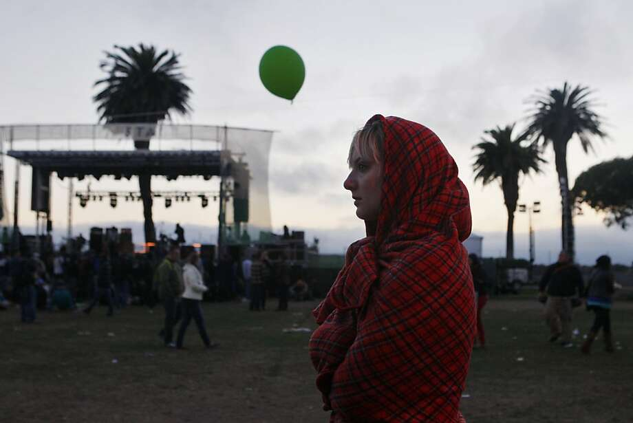 Heather Peterson tries to keep warm wrapped up in a blanket at the Treasure Island Music Festival in San Francisco, Calif. on Sunday, Oct. 20, 2013. Photo: Raphael Kluzniok, The Chronicle