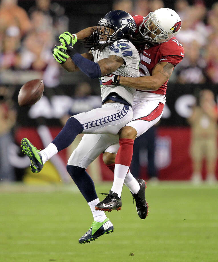 Seattle Seahawks cornerback Richard Sherman (25) breaks up a pass intended for Arizona Cardinals wide receiver Michael Floyd during the first half of an NFL football game, Thursday, Oct. 17, 2013, in Glendale, Ariz. Photo: Rick Scuteri, ASSOCIATED PRESS / AP2013