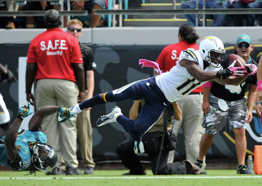 San Diego Chargers wide receiver Eddie Royal (11) catches a 27-yard pass for a touchdown as Jacksonville Jaguars strong safety Johnathan Cyprien, lower left, can't stop him during the first half of an NFL football game in Jacksonville, Fla., Sunday, Oct. 20, 2013. Photo: Stephen Morton, AP / FR56856 AP