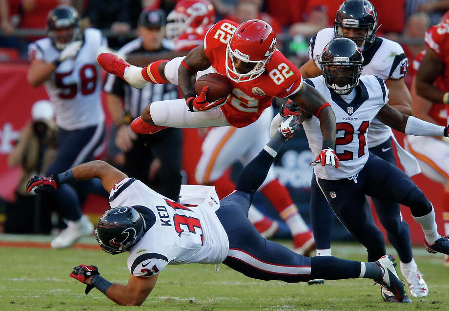 Kansas City Chiefs wide receiver Dwayne Bowe (82) is knocked down by Houston Texans free safety Shiloh Keo (31) during the first half of an NFL football game at Arrowhead Stadium in Kansas City, Mo., Sunday, Oct. 20, 2013. Photo: Ed Zurga, ASSOCIATED PRESS / AP2013