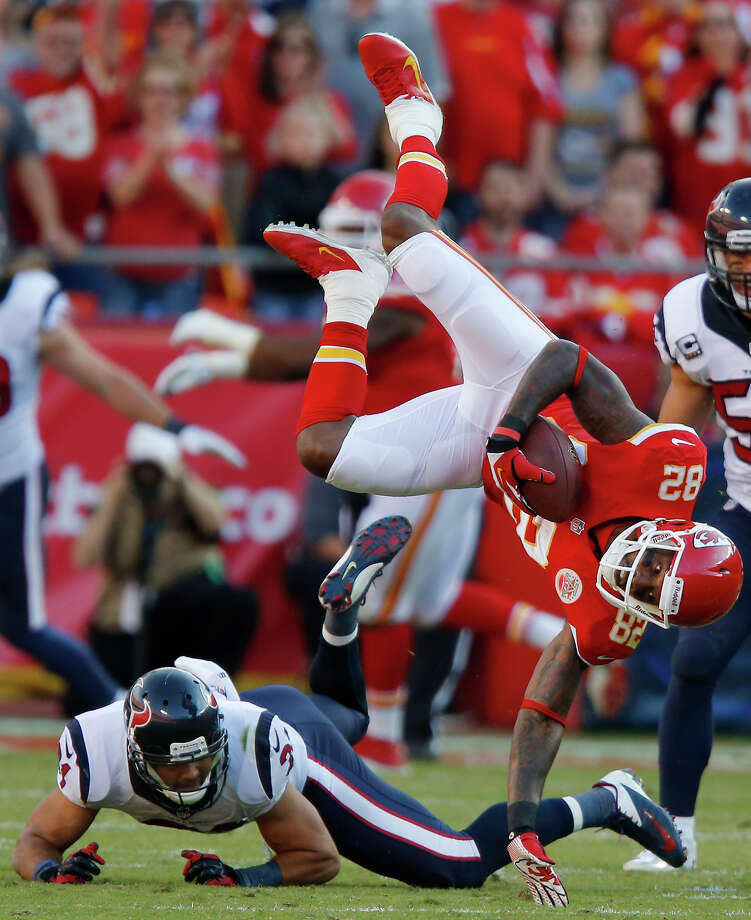 Kansas City Chiefs wide receiver Dwayne Bowe (82) is knocked down by Houston Texans free safety Shiloh Keo (31) during the first half of an NFL football game at Arrowhead Stadium in Kansas City, Mo., Sunday, Oct. 20, 2013. Photo: Ed Zurga, AP / FR34145 AP