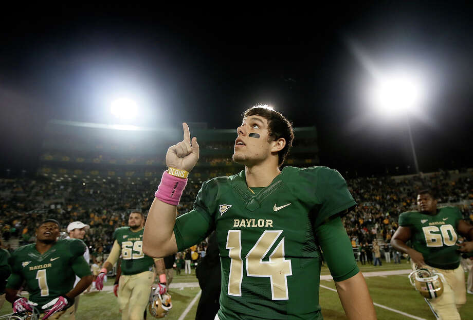 Baylor quarterback Bryce Petty (14) points to the sky following an NCAA college football game against Iowa State, Saturday, Oct. 19, 2013, in Waco, Texas. Baylor won 71-7. Photo: Tony Gutierrez, AP / AP