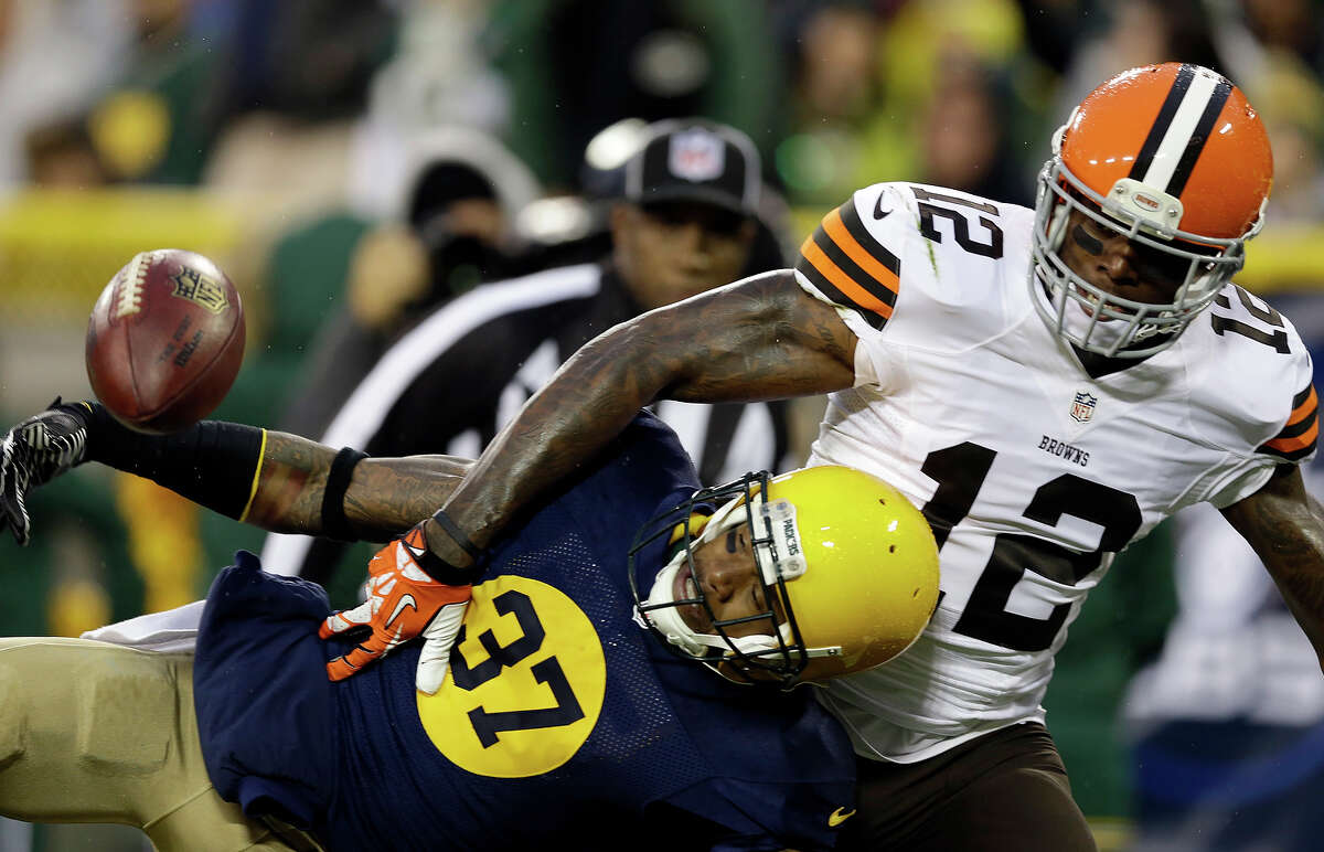 Green Bay Packers' Sam Shields (37) breaks up a pass intended for Cleveland Browns' Josh Gordon (12) during the second half of an NFL football game Sunday, Oct. 20, 2013, in Green Bay, Wis.