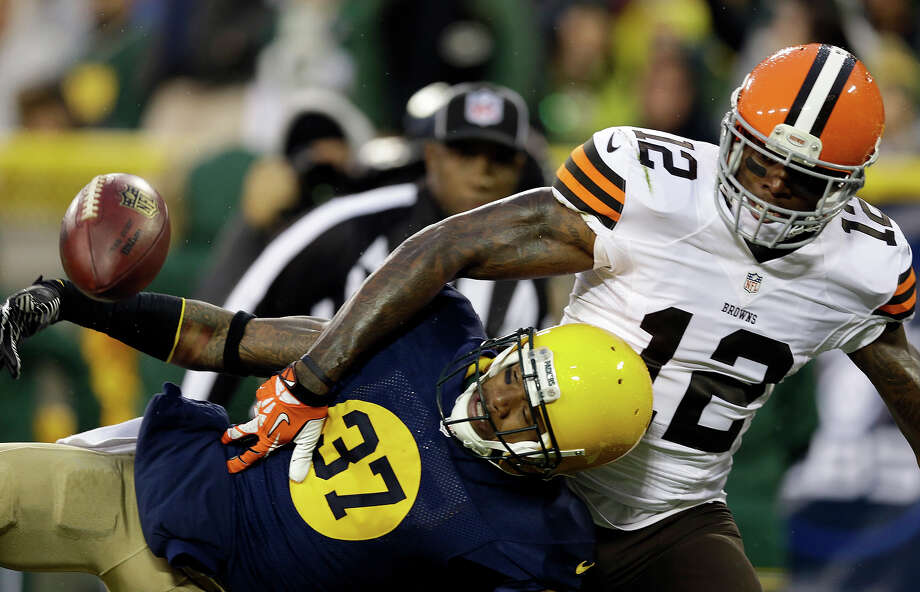 Green Bay Packers' Sam Shields (37) breaks up a pass intended for Cleveland Browns' Josh Gordon (12) during the second half of an NFL football game Sunday, Oct. 20, 2013, in Green Bay, Wis. Photo: Tom Lynn, ASSOCIATED PRESS / AP2013